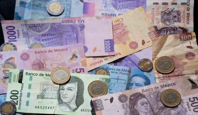 Different pesos bills and coins