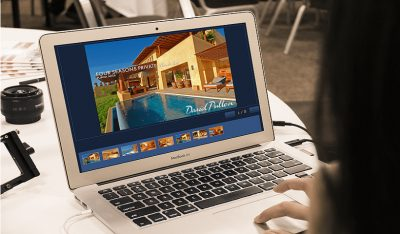 Girl reviiewing a home for sale in Puerto Vallarta Mexico on her laptop